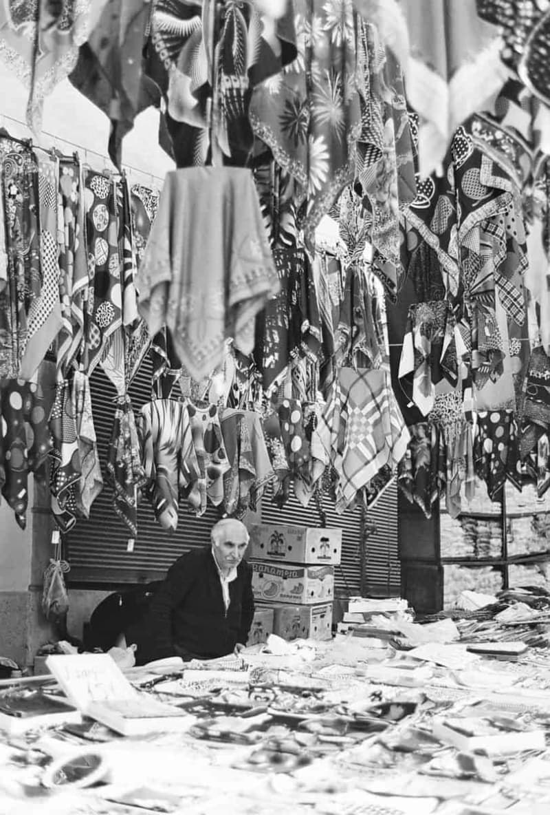 Turkish man selling scarves at a market
