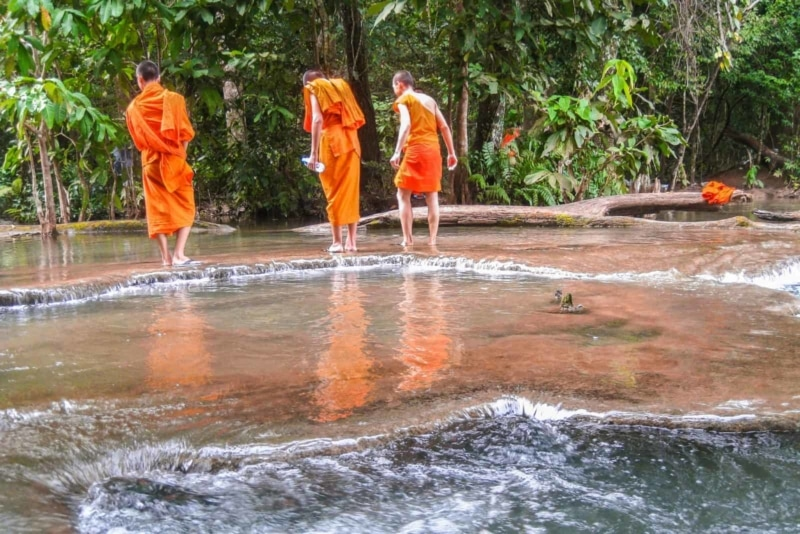 Monks at the Top of the Waterfall