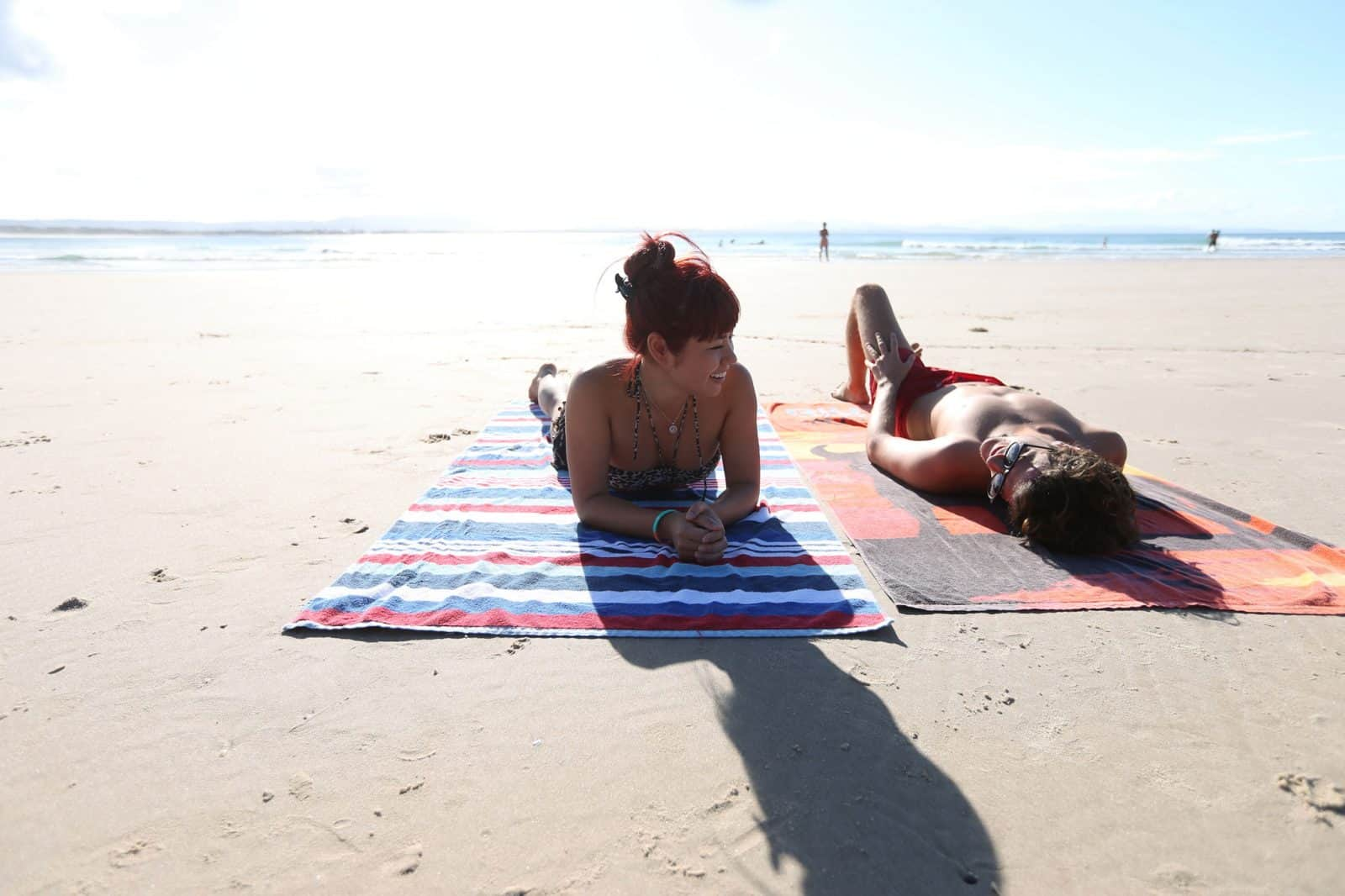 Lounging on the beach at Byron Bay