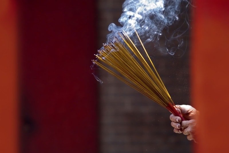 Burning incense at a temple in Ho Chi Minh City, Vietnam