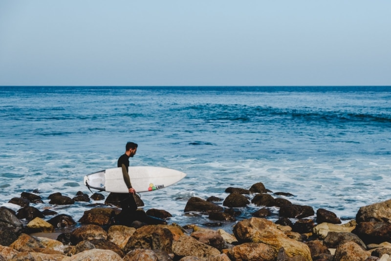 Checking out surfers in Malibu on my Pacific Coast Highway road trip itinerary.