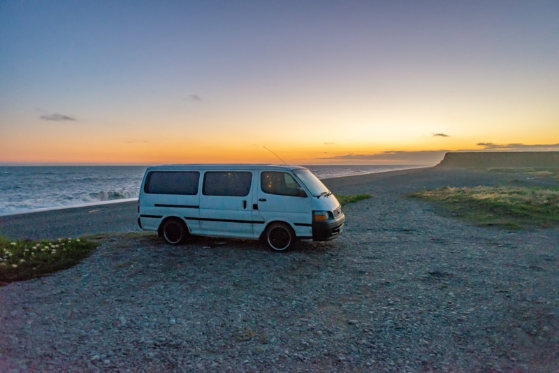 Staying in a self-contained campervan can help you backpack New Zealand on a budget.