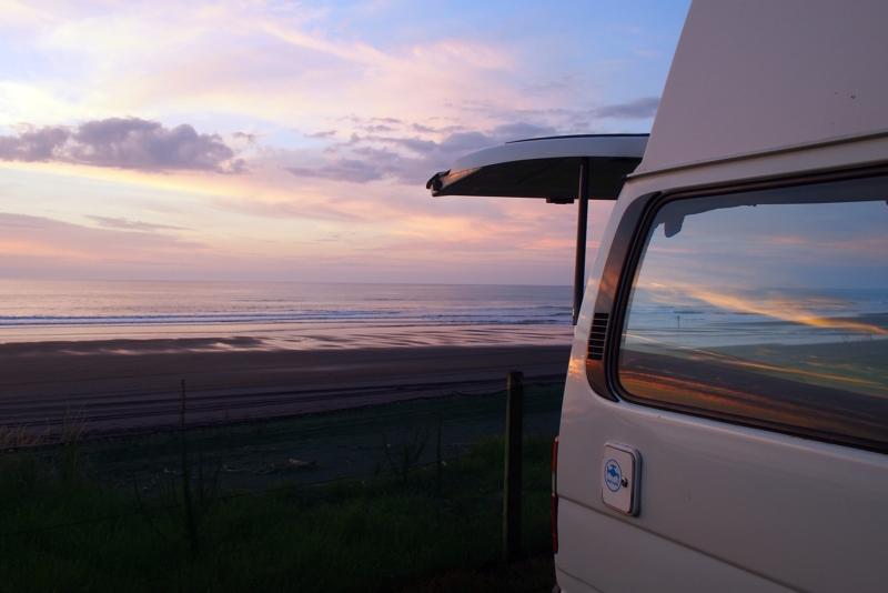 Sunset and an RV on a beach