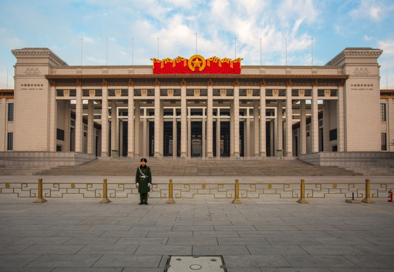 A soldier stands guard outside a building in Beijing
