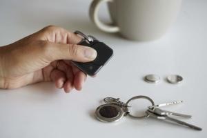 Tile Bluetooth Tracker next to a set of keys