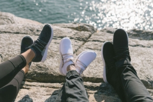 Three pairs of Vessi Everyday Shoes in front of the water