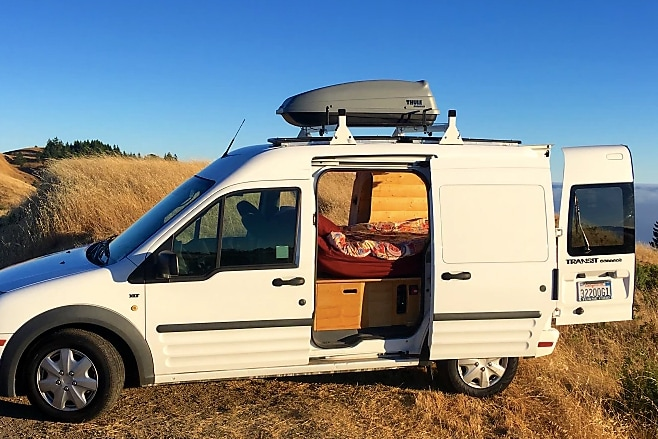 Cozy Ford Transit Connect Camper on the coast
