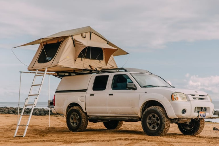 2004 Nissan Frontier with an open tent
