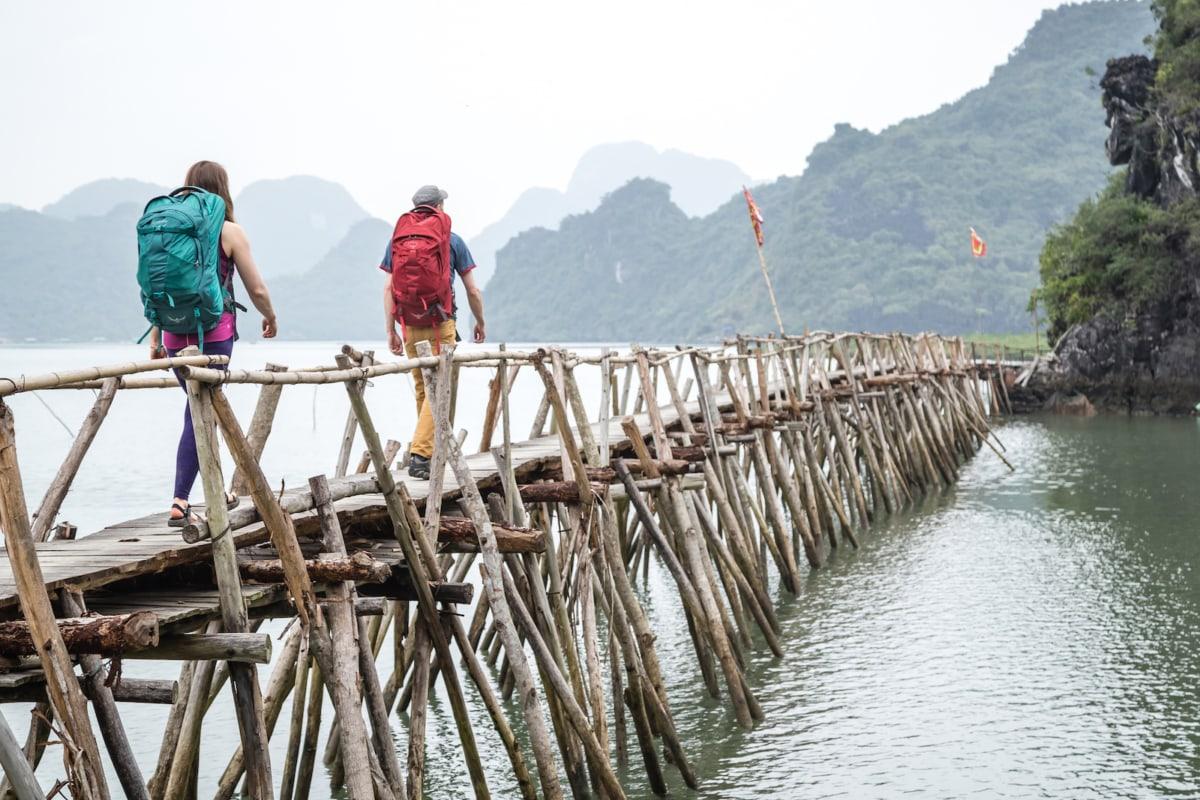 Eric Elofson and Ashley Buttelmann trek along a pier in Cat Ba National Park, Vietnam