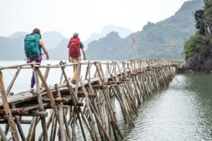 Eric Elofson and Ashley Buttelmann trek along a pier in Cat Ba National Park, Vietnam