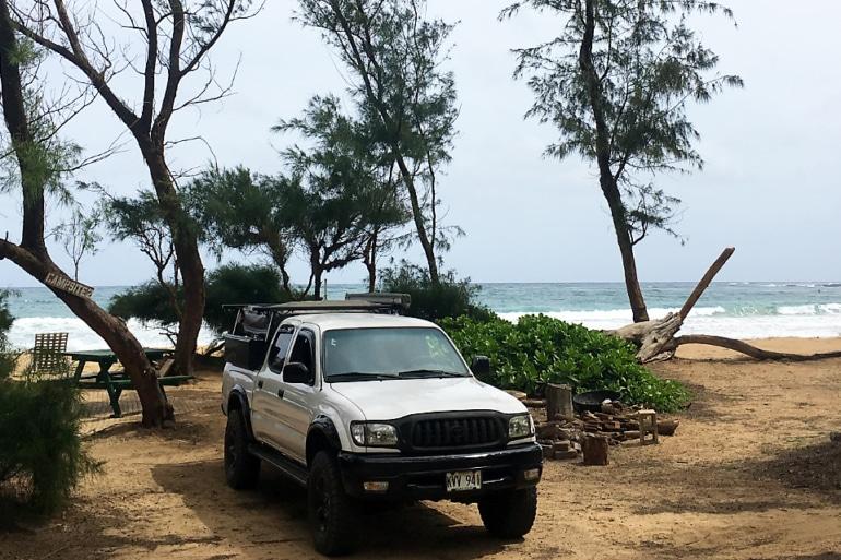 A 2004 Toyota Tacoma on the beach in Kauai