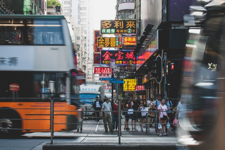 Bus travel in Hong Kong on a busy street