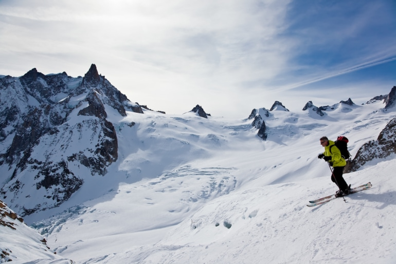 Male skier moving down in snow powder; envers du plan, vallèe blanche, Chamonix, Mont Blanc massif, France, Europe.