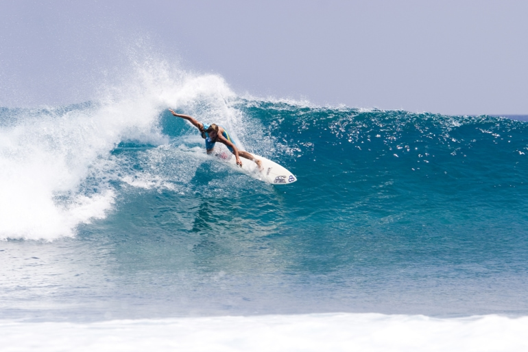 a man surfing in the Maldives
